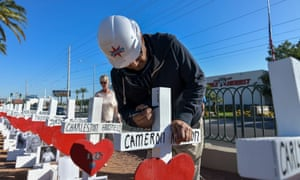 Greg Zanis delivers 58 crosses on the Las Vegas Strip for the two-year anniversary of the shooting in Las Vegas, Nevada, on 1 October.