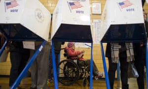 Queens, New York 90-year-old Chinese American Cy Yen Liu, center, checks her ballot as she waits behind ballot-filling booths at a polling station in Flushing section. Liu, originally from Shanghai, China, immigrated to the United States 50 years ago