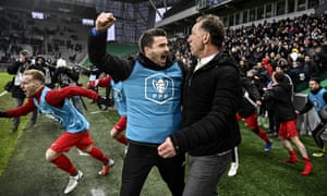 Andrezieux coach Jean Noel Cabezas celebrates with a player after their victory over Marseille.