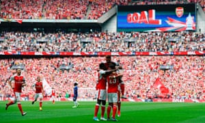 Arsenal's Alexis Sanchez celebrates with teammates after scoring the opening goal