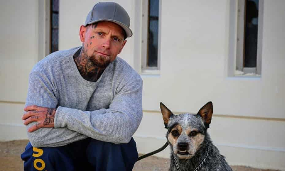 Behind barks: an inmate with his canine companion.