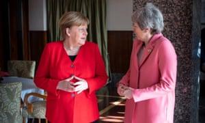 Angela Merkel and Theresa May meet at the Sharm el-Sheikh summit.