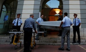 Workers carry a coffin