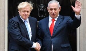 Boris Johnson greets the Israeli prime minister, Benjamin Netanyahu, outside No 10
