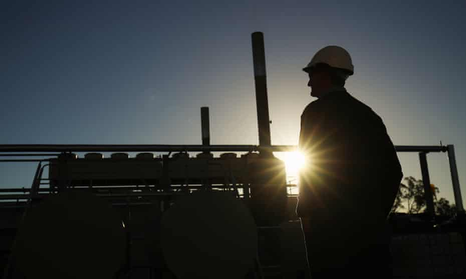 worker in silhouette at site of Santos's Wilga State power station in Narrabri