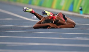 Faith Chepngetich Kipyegon drops to the ground after winning the women's 1500m.
