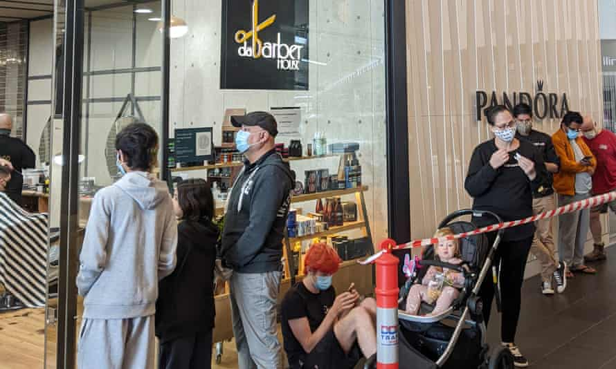 Melburnians queue up for their first haircut in months at Woodgrove Shopping Centre in Melton