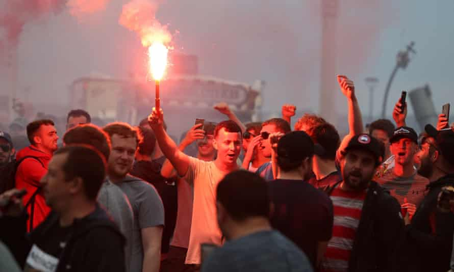 Liverpool fans lit off flares outside the Liver Building celebrating the club's Premier League triumph. Police have been granted further powers to disperse the crowds.
