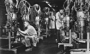 Production Line12th August 1968: Mechanics putting the finishing touches to six T58 turboshaft engines at the General Electric Company at Schenectady, New York. The engines are designed for use in helicopters and range in capacity to up to 1,500 horsepower. (Photo by Alan Band/Fox Photos/Getty Images)