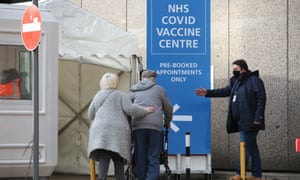 Members of the public arrive to receive their Covid-19 vaccinations at the Olympic Office Centre, Wembley, north London.