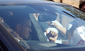 Gareth Bale waves to fans as he arrives in Enfield.