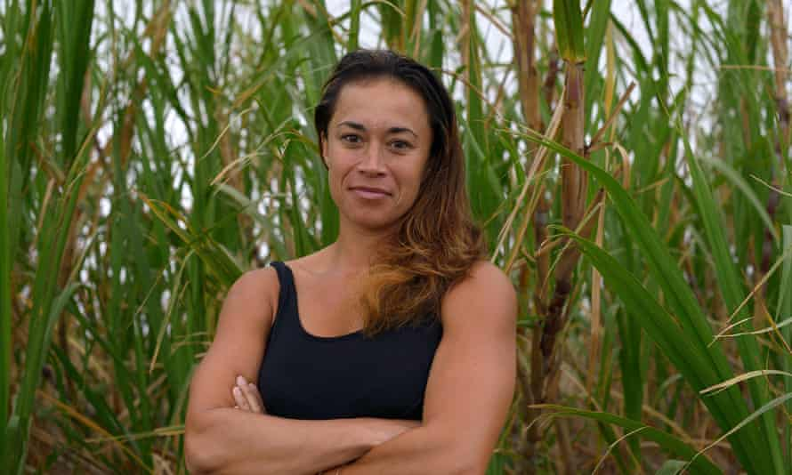 Tiare Lawrence, an activst for farmers in Maui and Hawaiian independence, standing next to sugar cane that will be the final crop farmed in Maui.