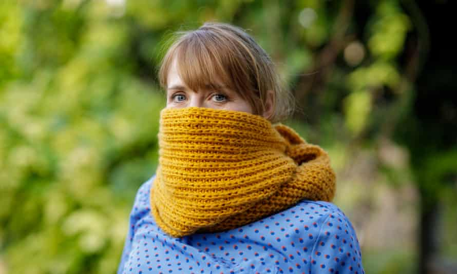 Woman with scarf wrapped around face