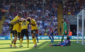 Aston Villa players celebrate after Pape Souare scored an own goal.
