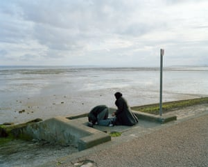 Southend, 6.45pm Day-trippers from east London perform Maghrib, the Islamic evening prayer on the promenade at Southend