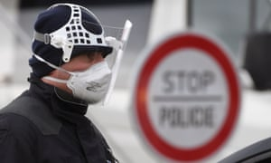 A Czech police officer during sanitary checks on drivers at the border crossing between Germany and Czech Republic.