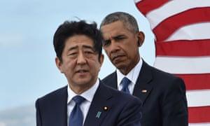 US president Barack Obama listens as Japanese prime minister Shinzo Abe speaks at the USS Arizona Memorial at Pearl Harbor in Honolulu.