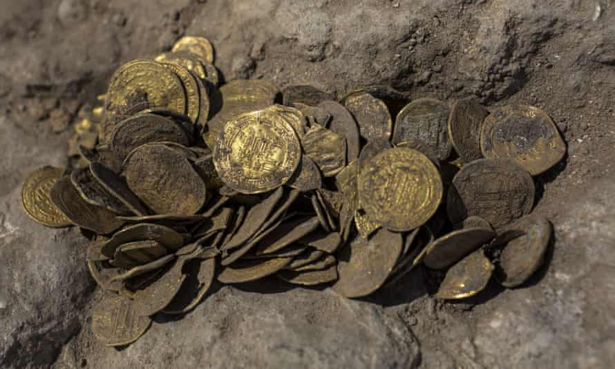 Some of the coins found at an archeological site in central Israel