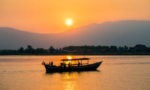 Boat on the Kampot river at sunset, Cambodia.