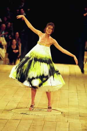 A model has her dress spray-painted live during Alexander McQueen's 1998 show.