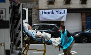 A man arrives at the emergency room of Lenox Hill Hospital in New York on Friday, when the city saw its largest single-day death toll from the coronavirus epidemic.
