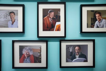 Photographs of famous actors reading for Audible audiobooks, on the wall at the company's studio in London