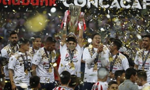 Chivas players hold the trophy aloft as they celebrate winning the Concacaf title for the first time since 1962