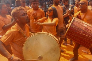 Devotees playing traditional drums