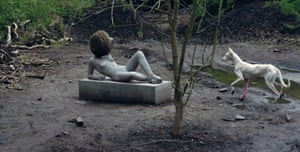 The dog called Human and the bee-encrusted statue in Huyghe's compost garden at Documenta.