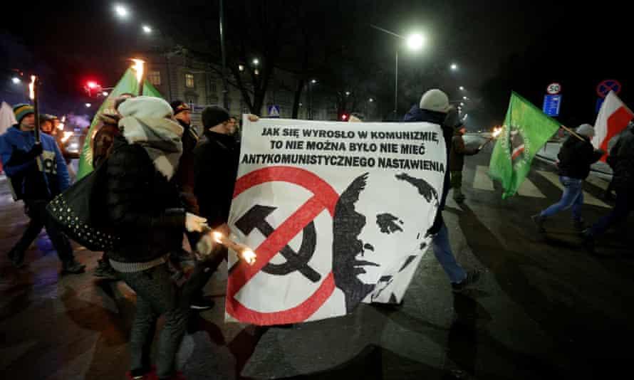Janusz Waluś's supporters in Kraków display his image.