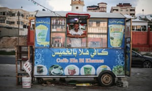 Issa Hassan, 22, in his a beachside coffee stall in Gaza.
