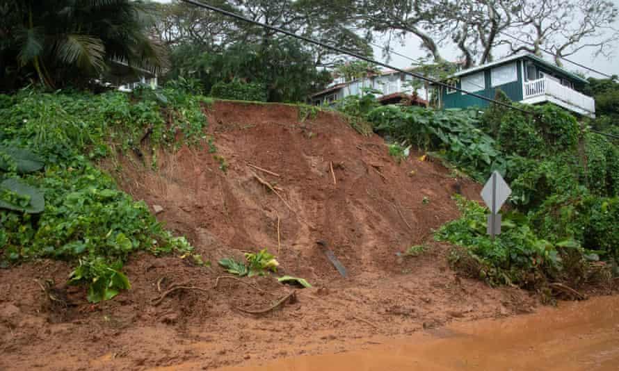 A mudslide leaves Kamehameha Highway coated near Pokole Point on 9 March.