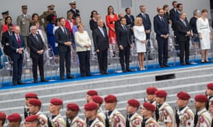 The Bastille Day parade in Paris watched by European leaders including Angela Merkel.