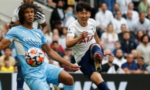 Striker Son Heung-Min (R) scores the opening goal
