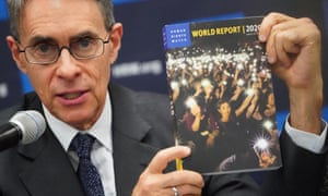 Kenneth Roth holds up Human Rights Watch World Report 2020