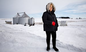 Barb Kalbach in snowy field with silos