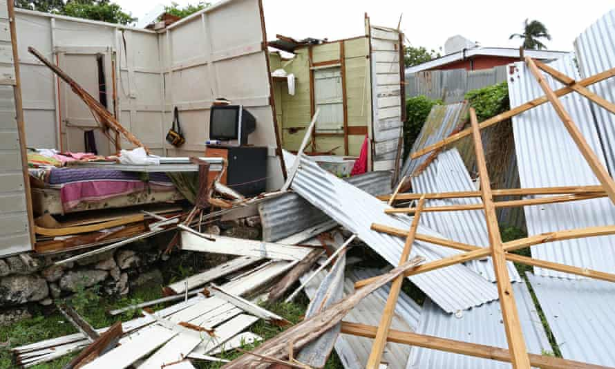 Debris lies in front of a house which lost its roof and walls after strong winds of Hurricane Elsa passed St Michael, Barbados.