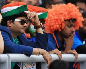 India fans look dejected at Old Trafford.