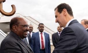 Bashir with Syrian President Bashar al-Assad in 2018.