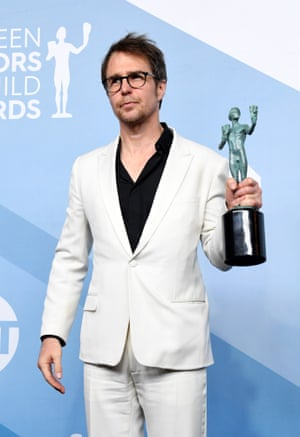 Sam Rockwell, poses in the press room