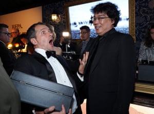 David Heyman and Bong Joon-ho chatting at the Beverly Hilton hotel