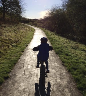 A boy on a bike in Dalby Forest.