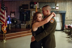 Young Marines attend a ball at a local VFW, Hanover, PA.Garett, a senior member of the Young Marines, dances with his girlfriend at a Young Marines attend a ball at the local VFW, 21 Oct 2017, Hanover, PA. The ball is celebrated once a year, with family and friends celebrating the students success in the program.Garett's mom had just given a speech in tears about his dedication to the Young Marines program, his character as a son, and his future. He's a senior in high school, and his boyhood is slipping away. Now, it seems as if every eye at the VFW in Hanover, Pennsylvania is looking at him. He dances nervously with his girlfriend. The Young Marines are a patriotic education program with around 10,000 students enrolled nationwide. Enrollment begins at the age of 8. Hanover, Pennsylvania.