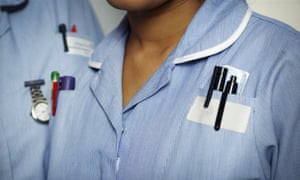 Close-up of two typically dressed NHS (National Health Service) nurses