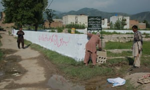 Pakistani workers mark the edges of the patch of ground where the house where Al-Qaida leader Osama Bin Laden was killed once stood in Abbottabad.