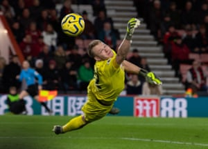 Aaron Ramsdale was kept busy at Bournemouth. Here he deals with a Liverpool free-kick in December.