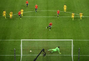 Sergio Ramos of Spain scores his team's first goal with a penalty.