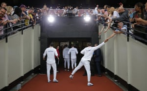 Great Britain's men's 4x100m relay team leave the stadium after receiving their gold medals.