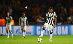 Juventus's Carlos Tevez looks dejected after Barca retook the lead.
