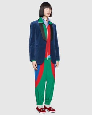 The Gucci shell suit wornwith a tuxedo jacket